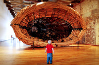 Liam Sanger, 5, admires a sculpture by Nari Ward in MASS MoCa in North Adams, Mass. during the Solid Sound Festival, curated by the band Wilco from June 24-26 at the museum.