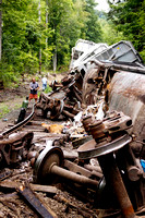 Onlookers stopped along Route 183 to get a look at the train that had been carrying construction debris bound for Connecticut that derailed along the Housatonic Railroad Line in Stockbridge, Mass.