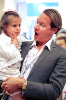Carson Kressley plays with Ariel Paduano, 5, after his talk at the Carousel Workshop at the Berkshire Mall in Lanesborough, Mass.