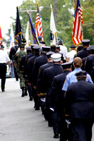 Pittsfield and Berkshire, Mass. police and fire departments march down the road after a ceremony at the Pittsfield Fire Department commemorating the 10th anniversary of the 9/11 attacks.
